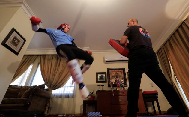 Hedaya Malak Wahba, Egyptian Taekwondo practitioner and 2016 Rio Olympics bronze medallist, works out with her brother at her home as she trains for the postponed Tokyo Olympic Games amid the spread of the coronavirus disease (COVID-19), in Cairo, Egypt June 4, 2020. Picture taken June 4, 2020. REUTERS/Amr Abdallah Dalsh (REUTERS)