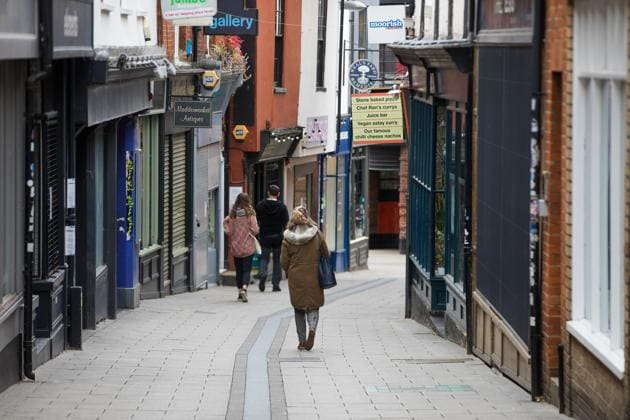 Pedestrians pass retail outlets on Lower Goat Lane in Norwich, UK on June 9, 2020.(Bloomberg)