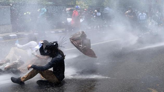 Police use water cannon to disperse demonstrators. Ten demonstrators who gathered near the Prime Minister's residence were arrested by the police, reported AFP. (Prakash Mathema / AFP)