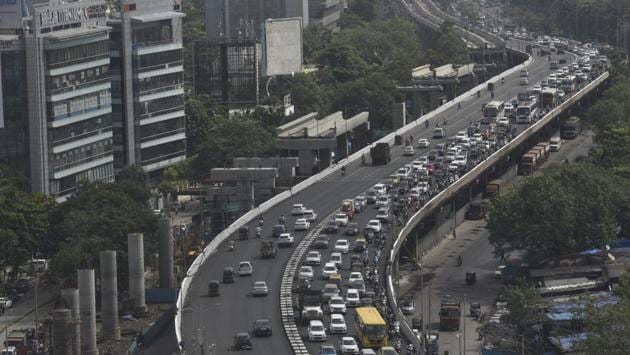 India's graded exit from lockdown set into motion by 'Unlock 1.0' brings with it familiar sights tweaked to life in the times of coronavirus. Among the first to greet cooped up Indians stepping out after months is the return of serpentine traffic seen along the Western Express Highway in Mumbai on June 8. (Satyabrata Tripathy / HT Photo)