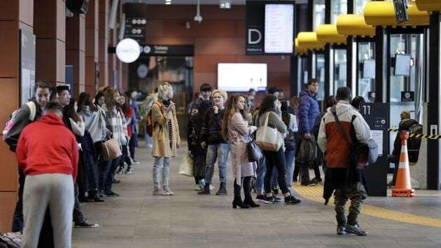 Commuters wait for transport at a bus interchange in Christchurch, New Zealand, Monday, June 8, 2020. New Zealand declared to have completely eradicated the coronavirus, at least for now,.(AP)