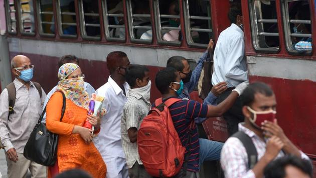 Commuters board a public transport bus at CST as government ease lockdown during Covid-19 pandemic in Mumbai on Wednesday.(Satish Bate/HT Photo)