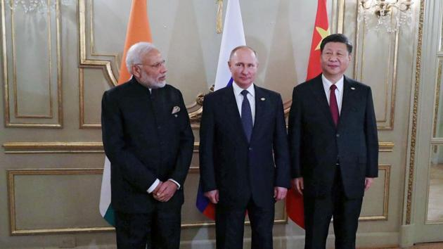 Prime Minister Narendra Modi (L), Russia's President Vladimir Putin (C) and China's President Xi Jinping, pose for pictures during a meeting in the sidelines of the G20 Summit in Buenos Aires, on November 30, 2018.(AFP/ File photo)