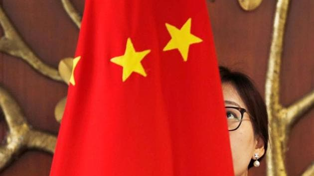REPRESENTATIVE IMAGE: A Chinese official adjusts a Chinese flag before the start of a meeting between Foreign Minister Wang Yi and Indian Foreign Minister Sushma Swaraj in New Delhi, India, December 21, 2018. REUTERS/Adnan Abidi/FILE PHOTO(REUTERS)