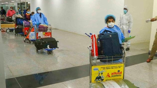 Passengers arrive from Kuwait by an Air India flight at Calicut International Airport during the Covid-19 pandemic in Kozhikode on May 14, 2020.(PTI File Photo)