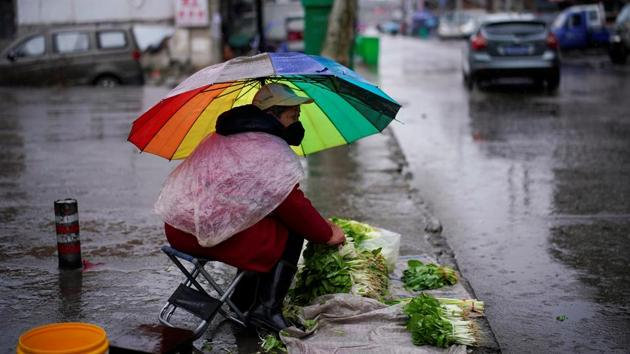 A vegetables vendor wearing a face mask waits for customers in the rain in Jingzhou, after the lockdown was eased in Hubei province, the epicentre of China's coronavirus disease outbreak.(REUTERS/For Representative Purposes Only)