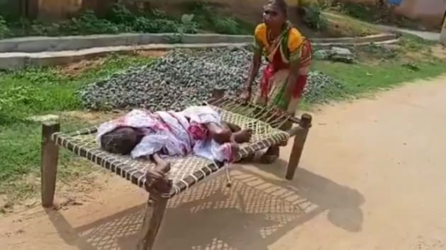 A video of 60-year-old Punjimati Dei of Bargaon village in Naupara district dragging a cot with her mother lying on it went viral on social media.(Screengrab)