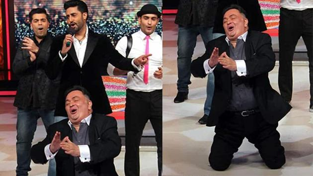 Rishi Kapoor showing a dance step at an awards event.