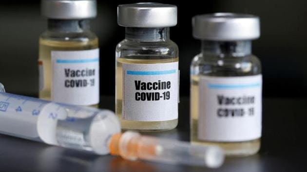 """FILE PHOTO: Small bottles labeled with a """"Vaccine COVID-19"""" sticker and a medical syringe are seen in this illustration taken taken April 10, 2020. REUTERS/Dado Ruvic/Illustration(REUTERS)"""