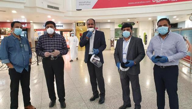 Hari Kumar(second from left) chartered an Air Arabia aircraft to fly 120 of his employees and 50 others to Kochi.(Sourced)