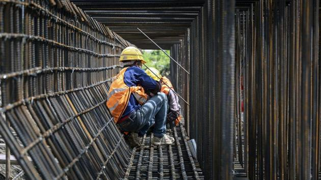 Workers labor at the construction site of an elevated highway on the outskirts of Shanghai, China on Friday.(Bloomberg Photo)