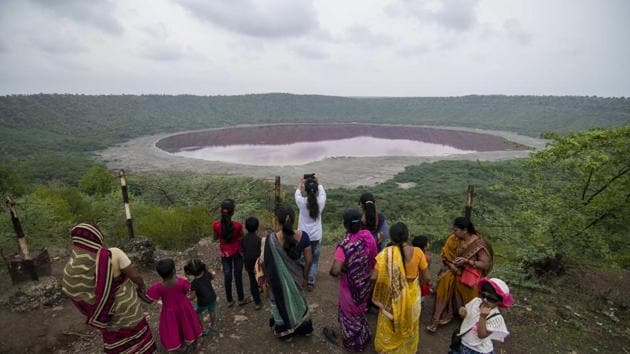 Locals in Buldhana gather around the Lonar lake after its water turned pink earlier this month.(Pratik Chorge/ Hindustan Times)