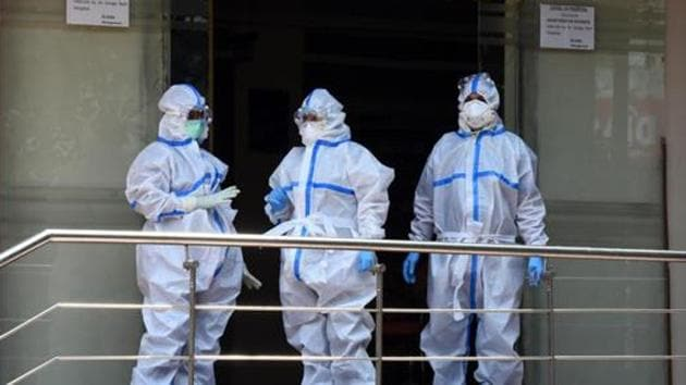 File photo: Medical professionals wearing PPE coveralls seen outside the Covid-19 ward at Sir Ganga Ram Hospital, in New Delhi.(Sonu Mehta/HT PHOTO)