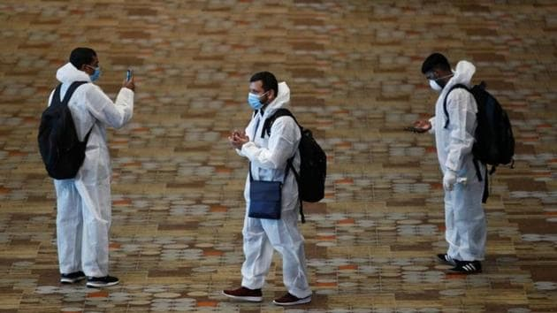 Seafarers who have spent the past months working onboard vessels arrive at the Changi Airport to board their flight back home to India during a crew change amid the coronavirus disease (COVID-19) outbreak in Singapore.(REUTERS)