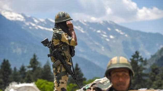 Border Security Force personnel stand guard along the Srinagar-Leh National highway, Ganderbal district of central Kashmir, June 17, 2020. Twenty army personnel including a colonel were killed during a clash with Chinese troops in Galwan Valley of the eastern Ladakh region on June 15(PTI)