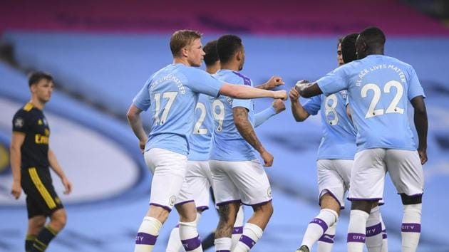Manchester City's Kevin De Bruyne, second left, celebrates after scoring the second goal from the penalty spot.(AP)