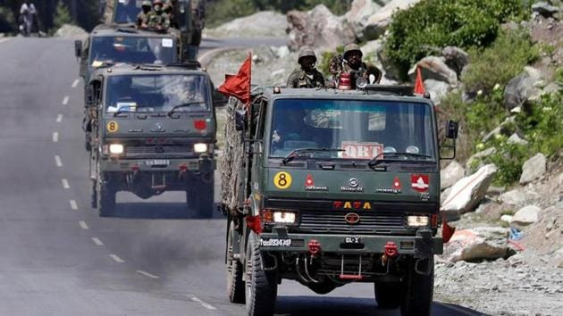 An Indian Army convoy moves along a highway leading to Ladakh, at Gagangeer in Kashmir's Ganderbal district, on June 18.(Reuters Photo)