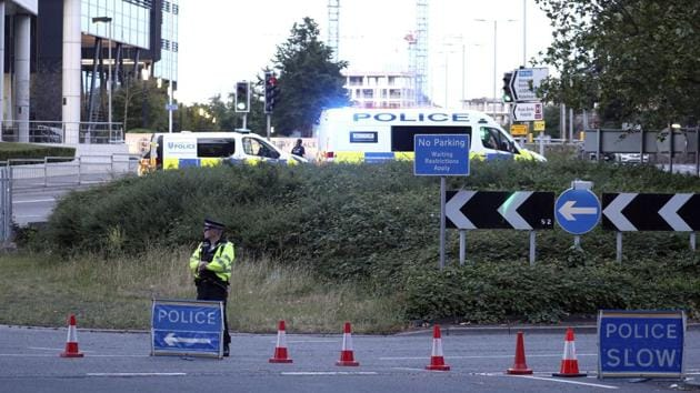 """Police investigate near Forbury Gardens in the town centre of Reading, England, where they are responding to a """"serious incident"""" Saturday.(AP)"""