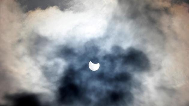 The annular solar eclipse occurs when the sun, moon and the earth come in a straight line.(Reuters Photo)
