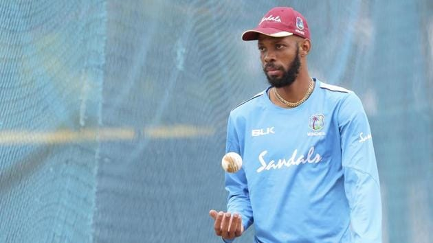 West Indies' Roston Chase tosses the ball as he prepares to bowl in the nets during a training session ahead of their first one day international cricket match against India, in Chennai.(AP)