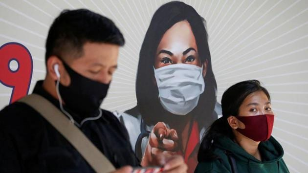 People are seen wearing protective face masks at a Sudirman train station in Jakarta, Indonesia.(via REUTERS)