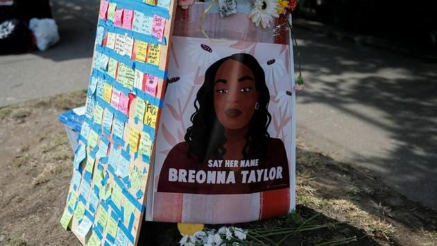 A portrait of Breonna Taylor is posted to a pole beside messages on sticky notes as protesters establish what they call an autonomous zone while continuing to protest against racial inequality and call for a defunding of Seattle police, in Seattle, Washington, US.(REUTERS)