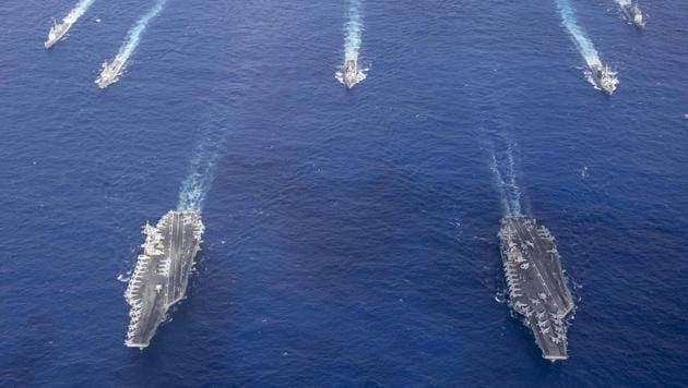 The Theodore Roosevelt Carrier Strike Group transits in formation with the Nimitz Carrier Strike Group while conducting dual carrier and airwing operations in the Philippine Sea.(US Navy photo)