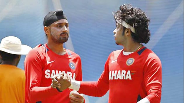 Harbhajan Singh with Sreesanth.