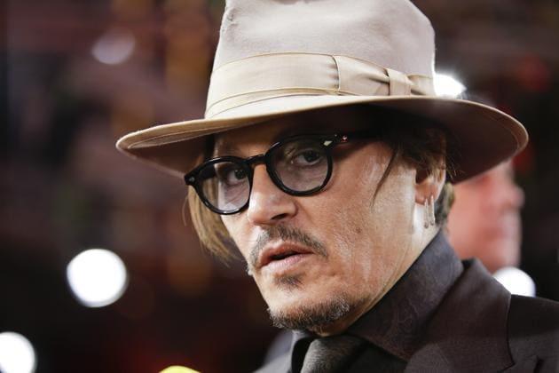Johnny Depp arrives for the screening of the film Minamata during the 70th International Film Festival Berlin.(AP)