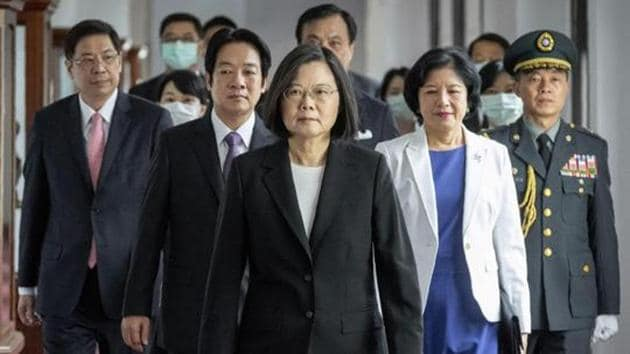 In this photo released by the Taiwan Presidential Office, President Tsai Ing-wen, walks ahead of Vice-President Lai Ching-te, as they attend an inauguration ceremony, Taipei, Taiwan, May 20, 2020(AP)