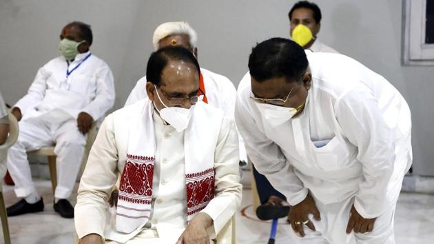 File photo of Madhya Pradesh Chief Minister Shivraj Singh Chouhan ( sitting) during Rajya Sabha election on June 19, 2020. Congress has raised the issue of a visit by the CM and other state and central BJP leaders to China in the past and Chouhan accepting hospitality of the Chinese Communist Party.(ANI File)