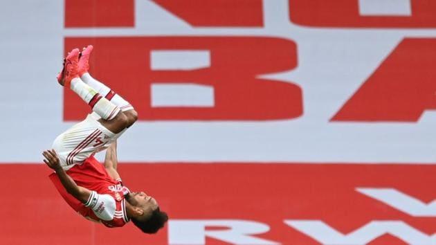 Arsenal's Pierre-Emerick Aubameyang celebrates scoring their third goal.(REUTERS)