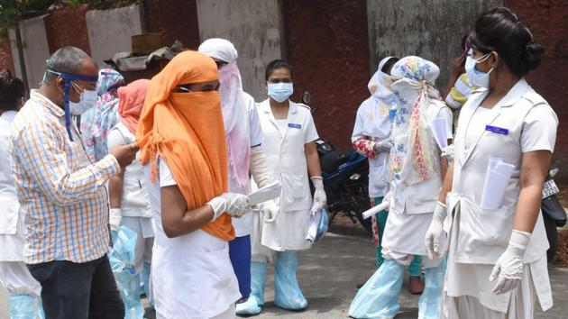 File photo: Health workers in protective gear during a large scale screening of residents in Ranchi, Jharkhand.(Diwakar Prasad/ Hindustan Times)