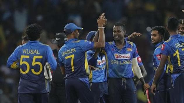 Pallekele: Sri Lankan team members celebrate their victory over West Indies' by six runs in the third one day international cricket match between Sri Lanka and West Indies in Pallekele, Sri Lanka, Sunday, March 1, 2020.(AP)