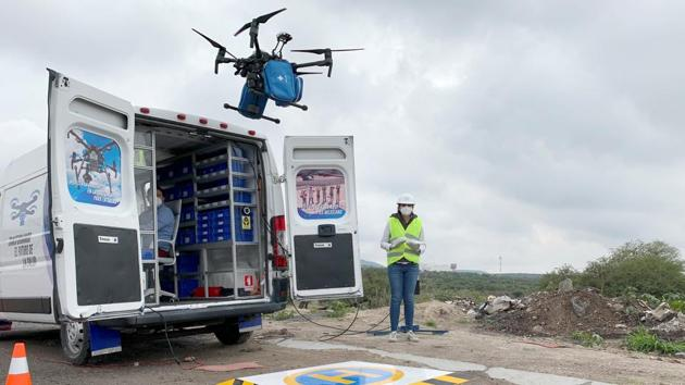 An employee of Sincronia Logistica looks at a drone loaded with personal protective gear and other essential equipment for delivery at a public hospital, in Queretaro, Mexico.(REUTERS)