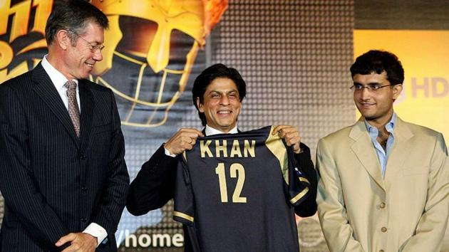 Indian actor and co-owner of the 'Kolkata' cricket team, Shahrukh Khan, (C) displays the team jersey watched by captain Sourav Ganguly (R) and coach John Buchanan during a press meet in Kolkata in March of 2008.(Getty Images)
