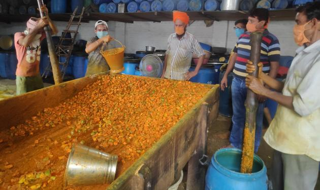 Men at work at a pickle factory in Panipat.(HT Photo)