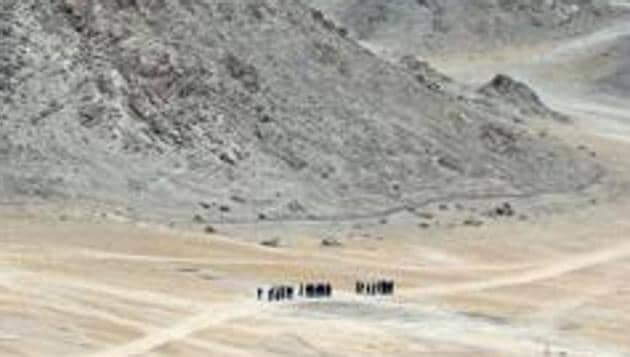 Indian soldiers walk at the foothills of a mountain range near Leh, the joint capital of the union territory of Ladakh, on June 24, 2020. - Indian fighter jets roared over the Indian Himalayan town of Leh on June 24 reinforcing simmering border tensions with China that military sources say has taken over a chunk of territory that India considers its own. (Photo by Tauseef MUSTAFA / AFP)(AFP file photo. Representative image)