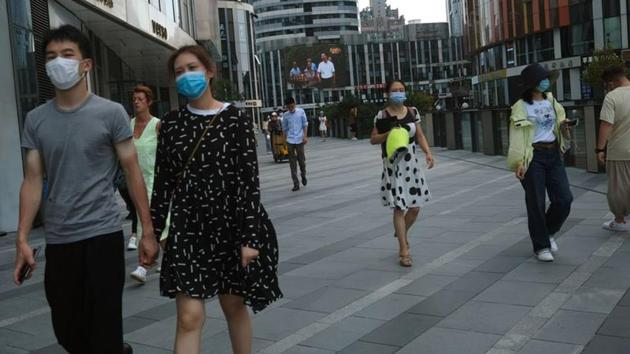 People wearing face masks are seen at the Sanlitun shopping area, following the outbreak of the coronavirus disease (Covid-19) in Beijing, China.(Reuters Photo/Representative Image)