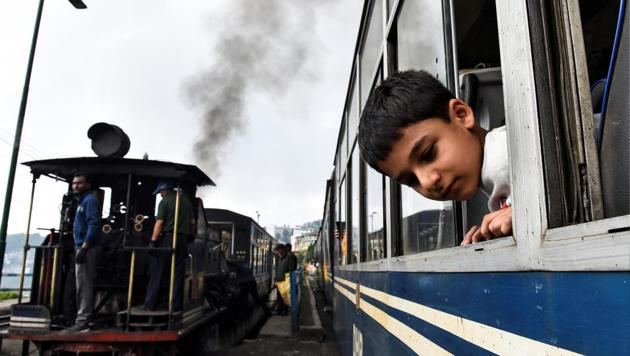 A boy looks out of a Darjeeling Himalayan Railway train, one of the main tourist draws in Darjeeling.(REUTERS)