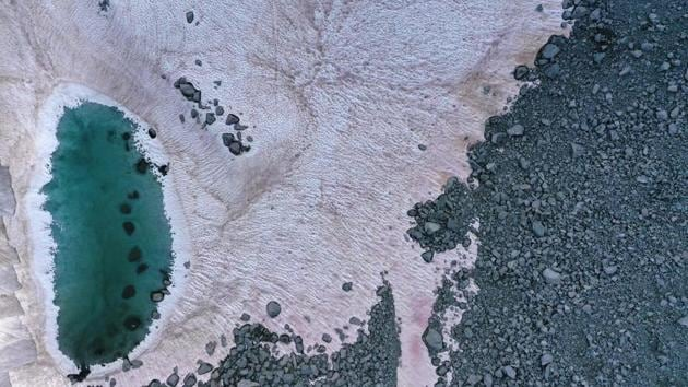 Photos: Pink ice in Italy's Alps sparks climate crisis concerns