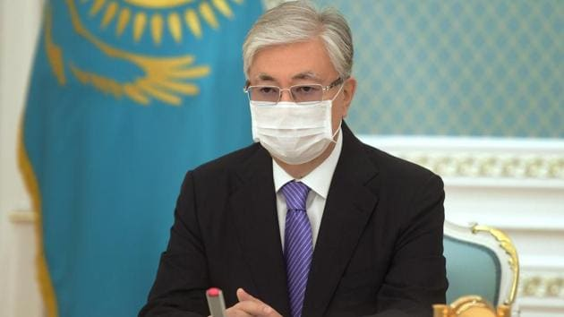 Kazakh President Kassym-Jomart Tokayev wearing a protective face mask participates online in the unveiling ceremony of a monument to Nursultan Nazarbayev, the first president of Kazakhstan, in Nur-Sultan, Kazakhstan.(via REUTERS)