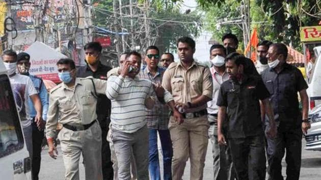 Ujjain: Gangster Vikas Dubey, the main accused in killing of eight policemen in the Kanpur encounter recently, being apprehended by police personnel after a nearly week-long manhunt, in Ujjain.(PTI)