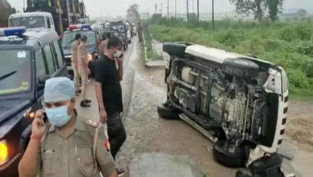 An overturned vehicle at the encounter site where gangster Vikas Dubey was killed while he tried to escape from the spot following an accident, near Kanpur on Friday morning.(PTI Photo)