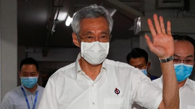 "Singapore's Prime Minister Lee Hsien Loong took the results in ""these circumstances"" as an ""endorsement"" of the party's policies and plans as he had called the elections amidst Covid-19 pandemic.(Reuters Photo)"