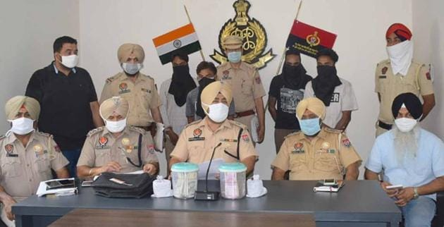 Additional deputy commissioner of police (ADCP-2) Jaskiranjit Singh Teja addressing a press conference about the arrests in Ludhiana on Saturday.(HT Photo)
