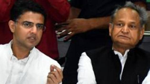 Rajasthan chief minister Ashok Gehlot with deputy chief minister Sachin Pilot during a party committee meeting at Pradesh Congress Committee Headquarters in Jaipur.(PTI File Photo)