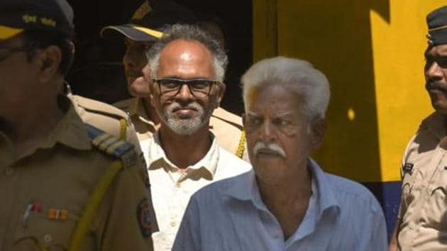 P Varavara Rao and Sudhir Dhawale, two of the nine accused in the Bhima Koregaon violence case, are escorted by police to court for a hearing, in Mumbai.(PTI file photo)