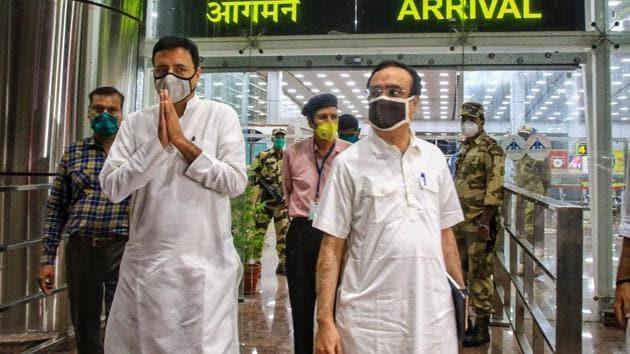 Senior Congress leaders Randeep Surjewala and Ajay Maken arrive at Jaipur Airport on Sunday.(PTI Photo)