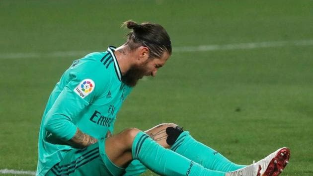 Real Madrid's Sergio Ramos after sustaining an injury, as play resumes behind closed doors following the outbreak of the coronavirus disease (COVID-19) REUTERS/Jon Nazca(REUTERS)